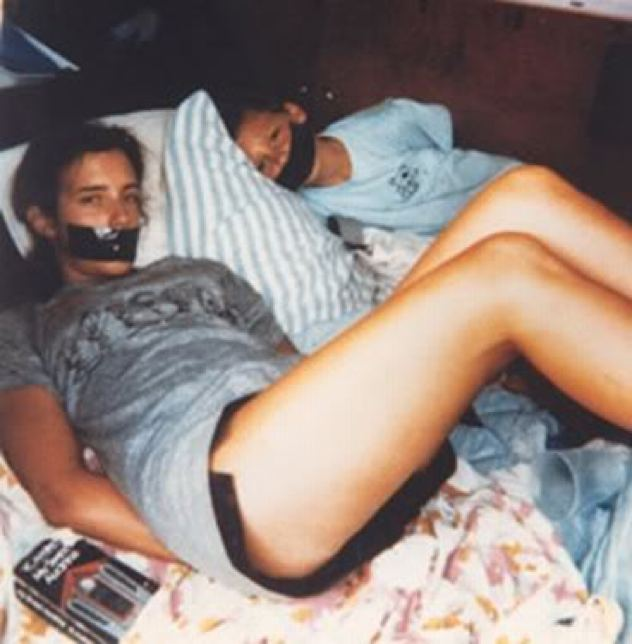 Photo of an unidentified young female and boy gagged and bound